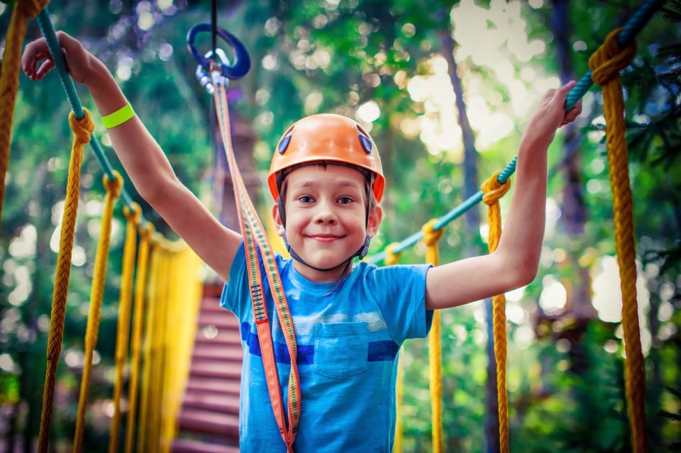 happy boy on the zipline at Summer Camp