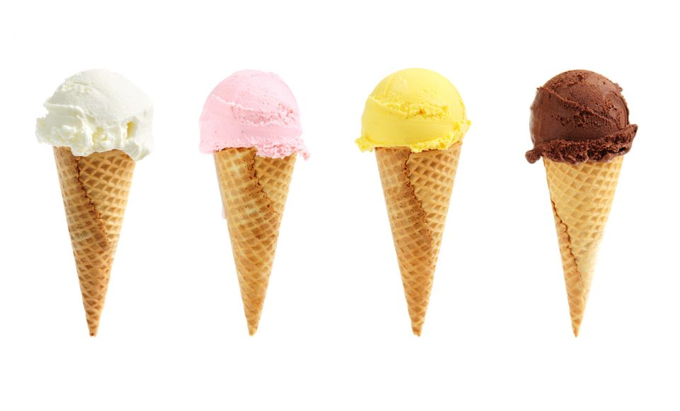 Assorted ice cream flavors in waffle cones